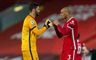 Liverpool's goalkeeper Alisson Becker (L) and Fabio Henrique Tavares 'Fabinho'