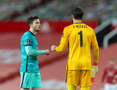 Liverpool's Andy Robertson (L) and goalkeeper Alisson Becker after the FA Cup 4th Round match between Manchester United FC and Liverpool FC at Old Trafford