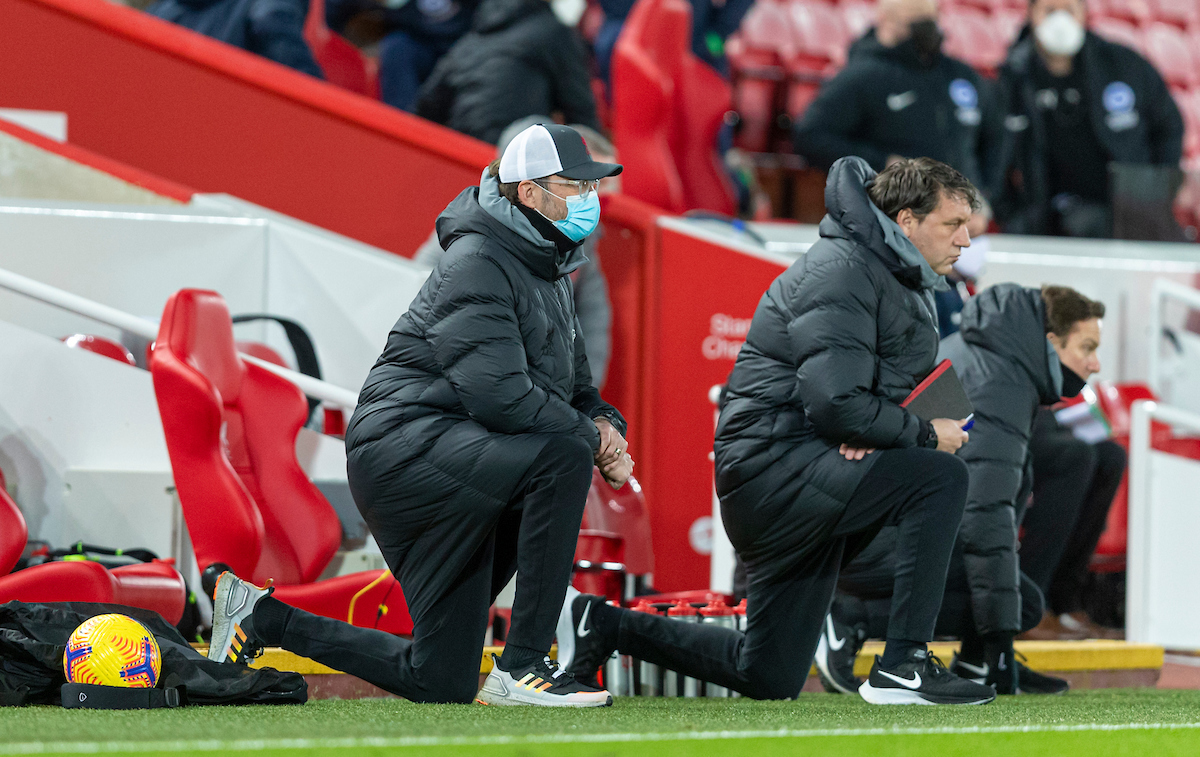 Liverpool's manager Jürgen Klopp kneels down (takes a knee) in support of the Black Lives Matter movement before the FA Premier League match between Liverpool FC and Brighton & Hove Albion FC at Anfield