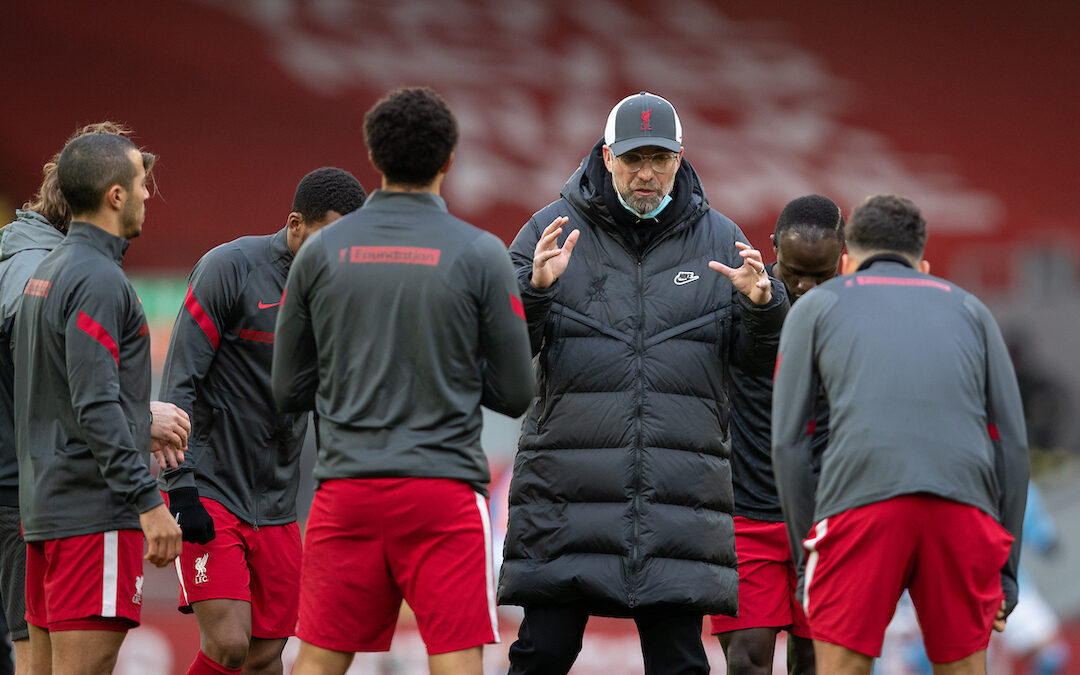 Liverpool's manager Jürgen Klopp speaks to his players during the pre-match warm-up before the FA Premier League match between Liverpool FC and Manchester City FC at Anfield