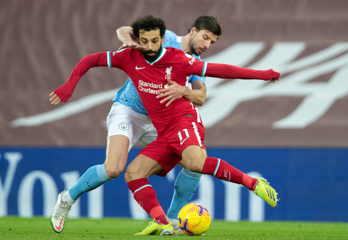 Liverpool's Mohamed Salah (L) and Manchester City's Rúben Dias during the FA Premier League match between Liverpool FC and Manchester City FC at Anfield