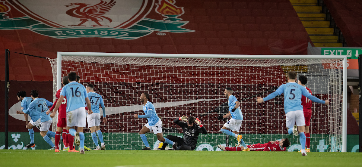 Liverpool's goalkeeper Alisson Becker looks dejected as Manchester City score the opening goal during the FA Premier League match between Liverpool FC and Manchester City FC at Anfield