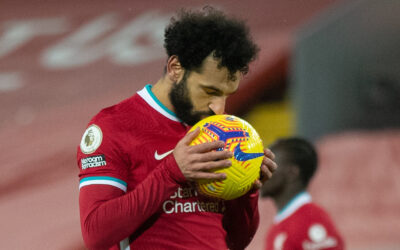 Liverpool's Mohamed Salah kisses the ball before scoring the first equalising goal from a penalty kick during the FA Premier League match between Liverpool FC and Manchester City FC at Anfield