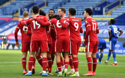 Liverpool's Mohamed Salah (hidden) celebrates with team-mates after scoring the first goal during the FA Premier League match between Leicester City FC and Liverpool FC at the King Power Stadium