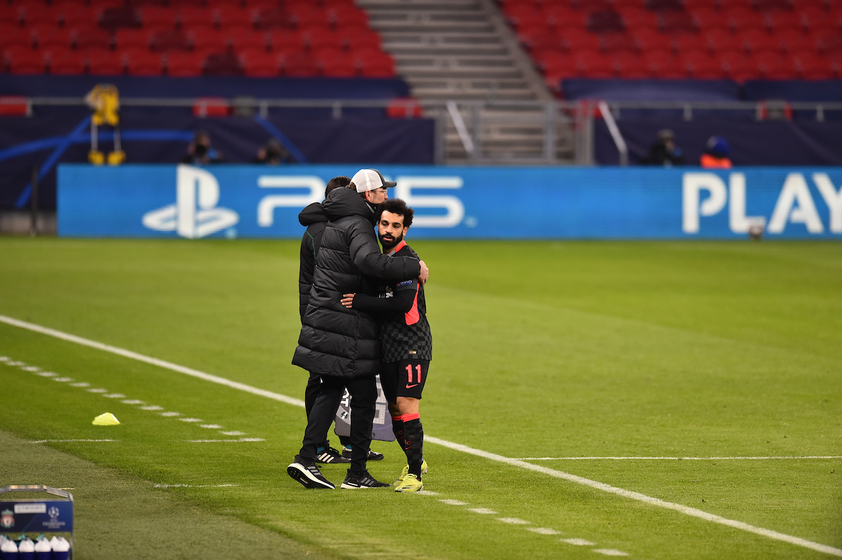Liverpool's Mohamed Salah is embraced by manager Jürgen Klopp as he is substituted during the UEFA Champions League Round of 16 1st Leg game between RB Leipzig and Liverpool FC at the Puskás Aréna