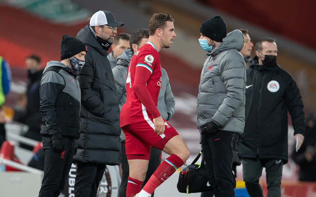 Liverpool's captain Jordan Henderson walks off injured during the FA Premier League match between Liverpool FC and Everton FC, the 238th Merseyside Derby, at Anfield