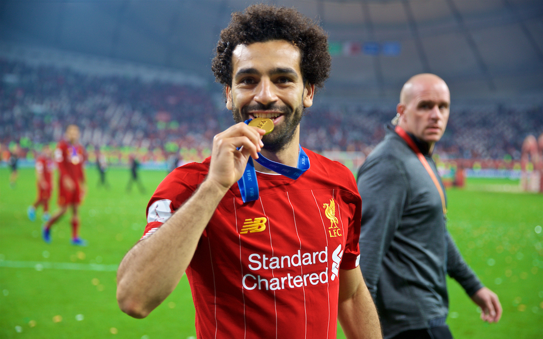 Liverpool's Mohamed Salah bites his winners' medal after the FIFA Club World Cup Qatar 2019 Final match between CR Flamengo and Liverpool FC at the Khalifa Stadium