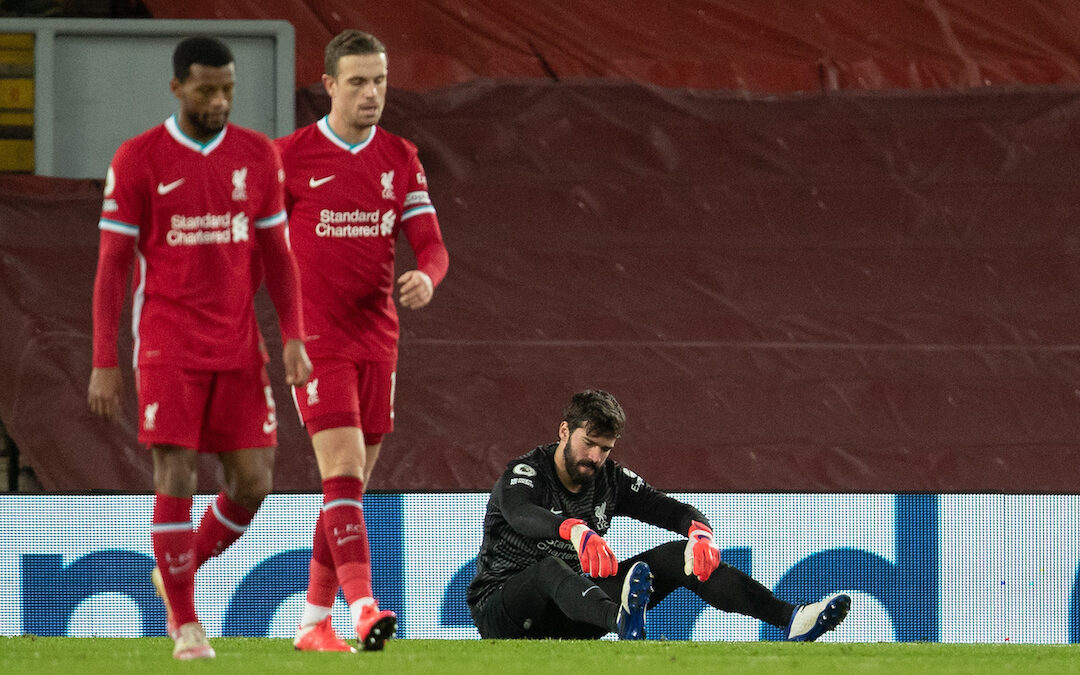 Liverpool's goalkeeper Alisson Becker looks dejected as Manchester City score the second goal during the FA Premier League match between Liverpool FC and Manchester City FC at Anfield