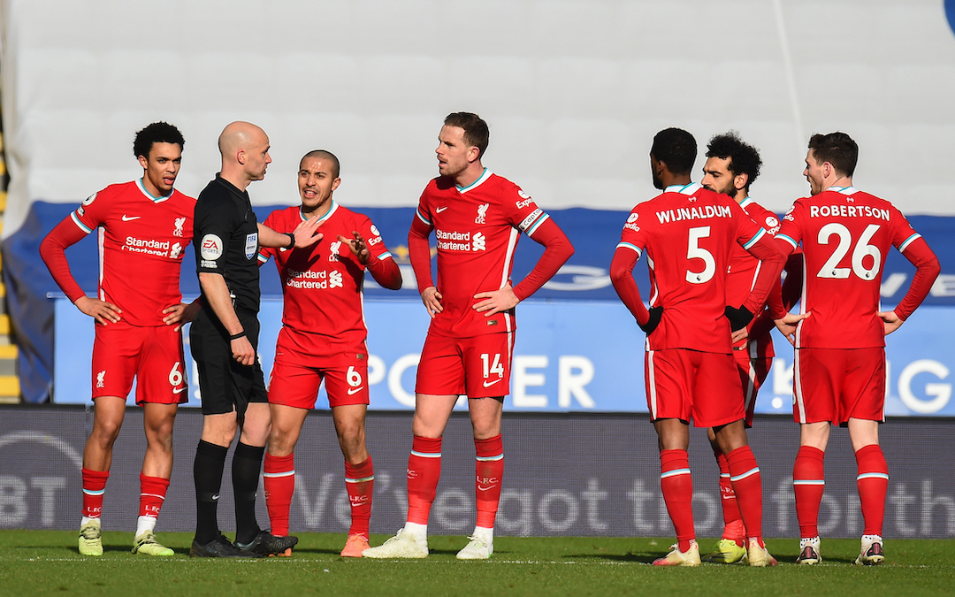 Liverpool's Trent Alexander-Arnold, Thiago Alcantara and captain Jordan Henderson speak with referee Anthony Taylor during a VAR decision for a penalty during the FA Premier League match between Leicester City FC and Liverpool FC at the King Power Stadium