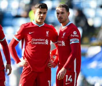 Liverpool's Ozan Kabak (L) and captain Jordan Henderson during the FA Premier League match between Leicester City FC and Liverpool FC at the King Power Stadium