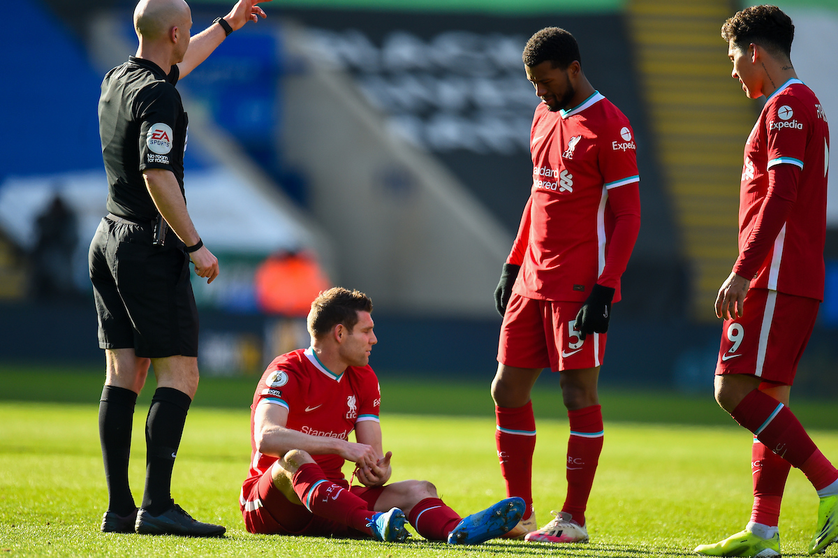 Liverpool's James Milner goes down injured during the FA Premier League match between Leicester City FC and Liverpool FC at the King Power Stadium