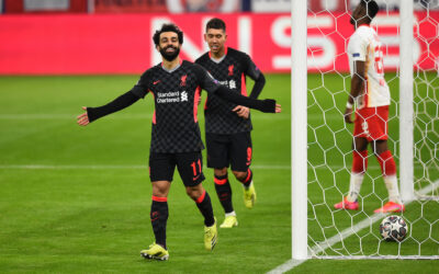 Liverpool's Mohamed Salah celebrates after scoring the first goal during the UEFA Champions League Round of 16 1st Leg game between RB Leipzig and Liverpool FC at the Puskás Aréna