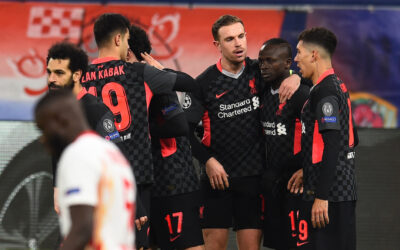 Liverpool's Sadio Mané celebrates with team-mates after scoring the second goal during the UEFA Champions League Round of 16 1st Leg game between RB Leipzig and Liverpool FC at the Puskás Aréna