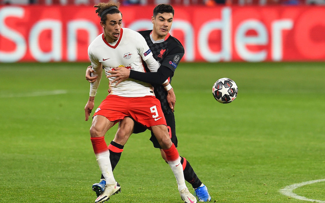 Liverpool's Ozan Kabak (R) and RB Leipzig's Yussuf Poulsen during the UEFA Champions League Round of 16 1st Leg game between RB Leipzig and Liverpool FC at the Puskás Aréna