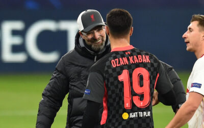 Liverpool's manager Jürgen Klopp and Ozan Kabak after the UEFA Champions League Round of 16 1st Leg game between RB Leipzig and Liverpool FC at the Puskás Aréna