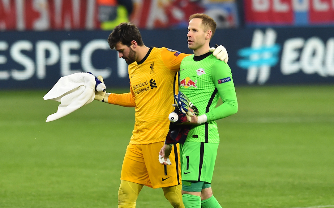 Liverpool's goalkeeper Alisson Becker (L) and RB Leipzig's goalkeeper Péter Gulácsi after the UEFA Champions League Round of 16 1st Leg game between RB Leipzig and Liverpool FC at the Puskás Aréna