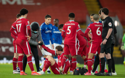 Liverpool's captain Jordan Henderson goes down injured during the FA Premier League match between Liverpool FC and Everton FC, the 238th Merseyside Derby, at Anfield