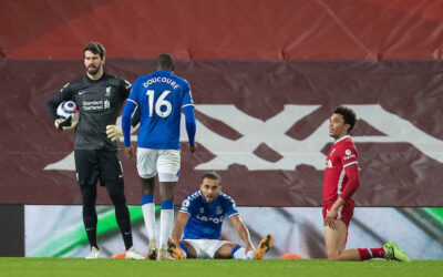 Liverpool's goalkeeper Alisson Becker looks dejected as Everton's Dominic Calvert-Lewin wins a penalty during the FA Premier League match between Liverpool FC and Everton FC, the 238th Merseyside Derby, at Anfield