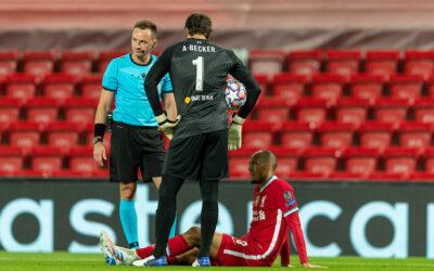 Liverpool v Chelsea: The Team Talk - Fabio Henrique Tavares 'Fabinho' goes down injured as goalkeeper Alisson Becker looks on