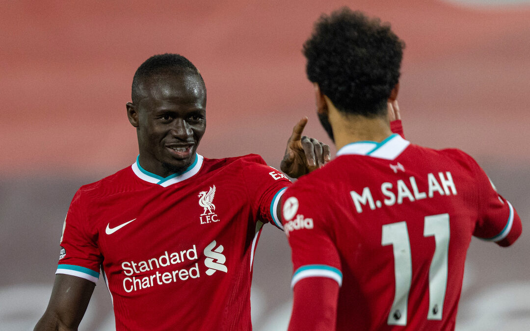 Sadio Mane celebrates with Mohamed Salah during the Premier League match between Liverpool FC and Wolves