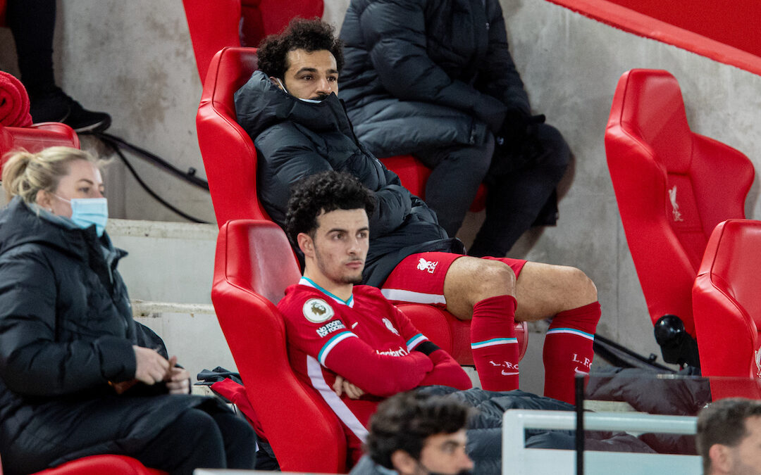 Liverpool's Mohamed Salah on the bench after being substituted during the FA Premier League match between Liverpool FC and Chelsea FC at Anfield