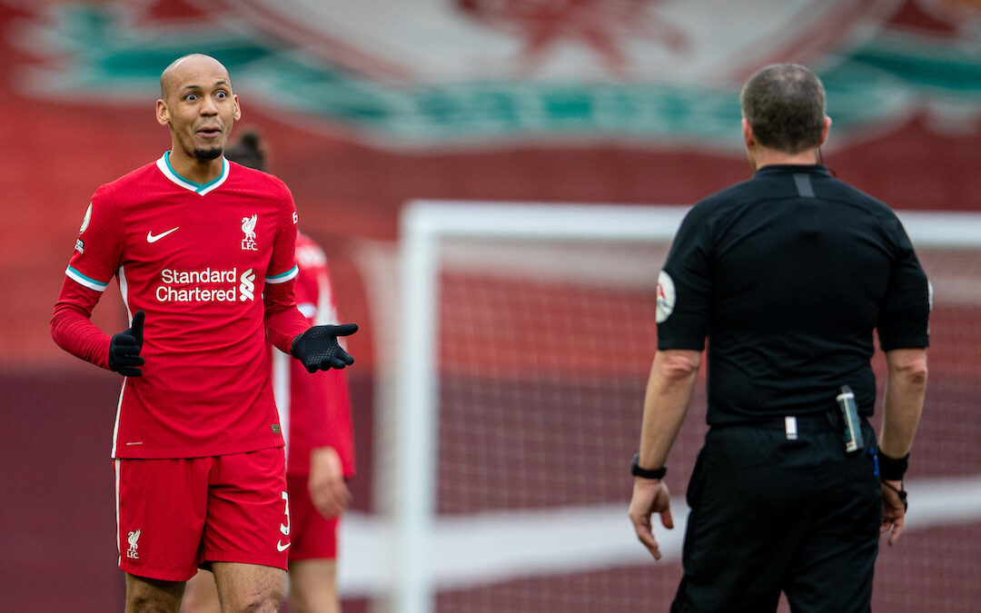 Liverpool's Fabio Henrique Tavares 'Fabinho' speaks with referee Kevin Friend during the FA Premier League match between Liverpool FC and Fulham FC at Anfield. Fulham won 1-0 extending Liverpool's run to six consecutive home defeats.
