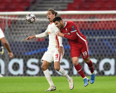 Liverpool's Ozan Kabak and RB Leipzig's Yussuf Poulsen during the UEFA Champions League Round of 16 second Leg game between Liverpool FC and RB Leipzig at the Puskás Aréna
