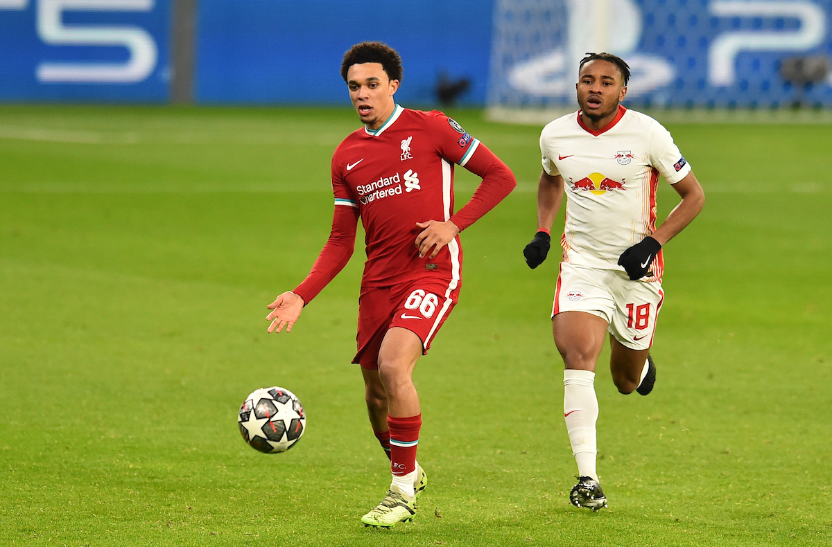 Liverpool's Trent Alexander-Arnold (L) and RB Leipzig's Christopher Nkunku during the UEFA Champions League Round of 16 2nd Leg game between Liverpool FC and RB Leipzig at the Puskás Aréna
