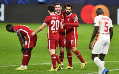 Liverpool's Mohamed Salah (R) celebrates after scoring the first goal during the UEFA Champions League Round of 16 2nd Leg game between Liverpool FC and RB Leipzig at the Puskás Aréna