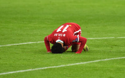 Liverpool's Mohamed Salah kneels to pray as he celebrates after scoring the first goal during the UEFA Champions League Round of 16 2nd Leg game between Liverpool FC and RB Leipzig at the Puskás Aréna