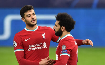 Liverpool's Ozan Kabak celebrates with Mohamed Salah during the UEFA Champions League Round of 16 second Leg game between Liverpool FC and RB Leipzig at the Puskás Aréna