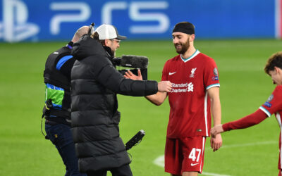 Liverpool's manager Jürgen Klopp embraces Nathaniel Phillips after the UEFA Champions League Round of 16 2nd Leg game between Liverpool FC and RB Leipzig at the Puskás Aréna