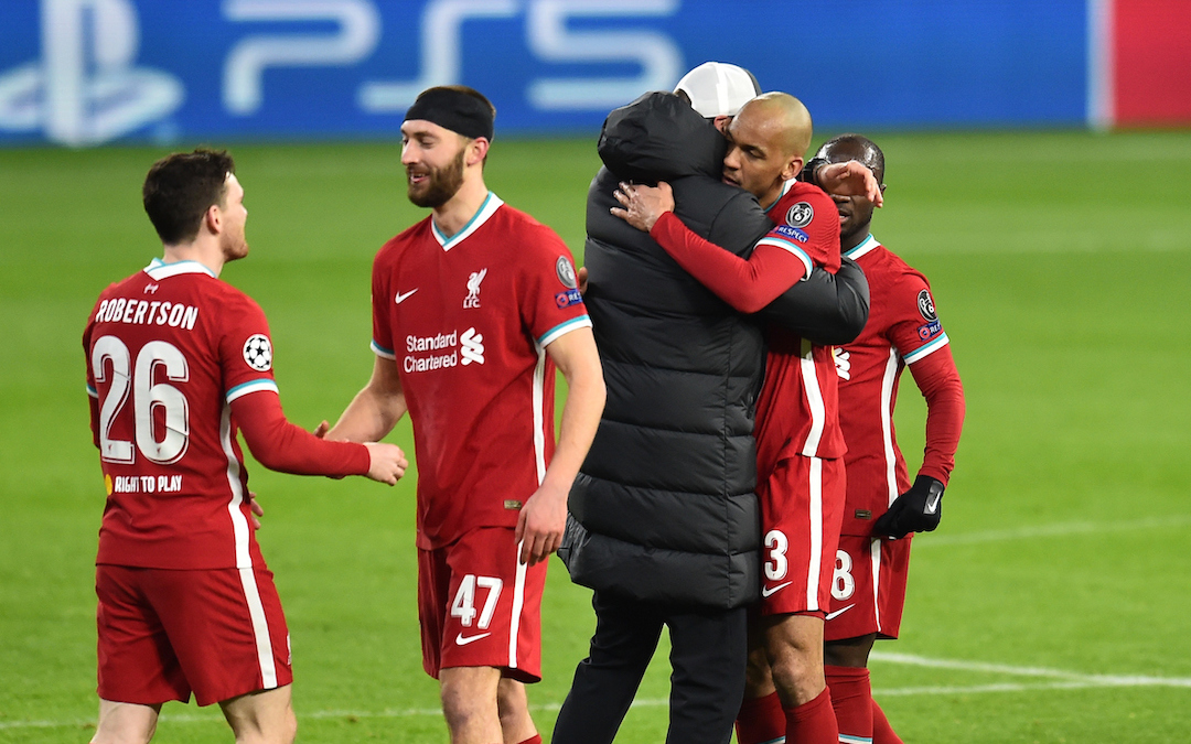 Liverpool's manager Jürgen Klopp embraces Fabio Henrique Tavares 'Fabinho' after the UEFA Champions League Round of 16 2nd Leg game between Liverpool FC and RB Leipzig at the Puskás Aréna
