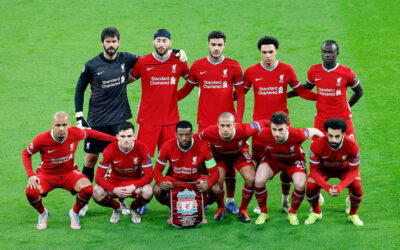 Liverpool's players line-up for a team group photograph before the UEFA Champions League Round of 16 2nd Leg game between Liverpool FC and RB Leipzig at the Puskás Aréna