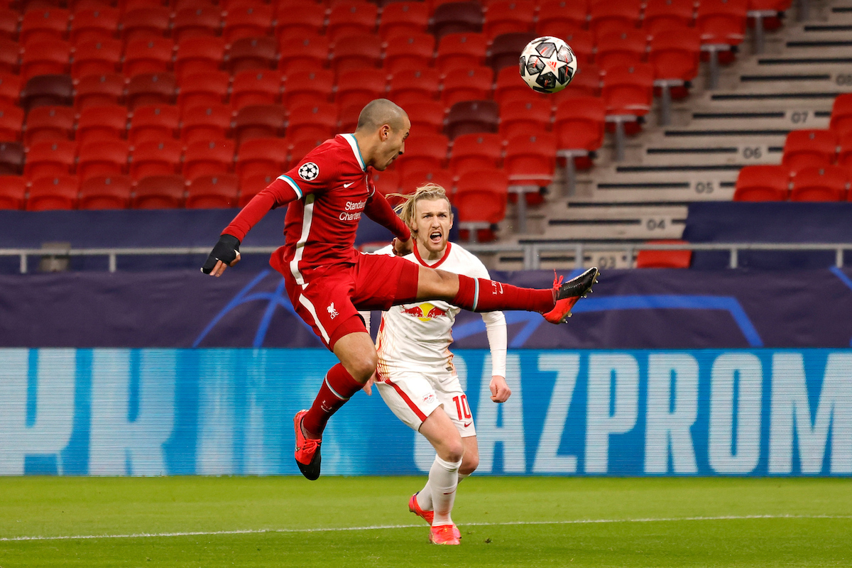 Liverpool's Thiago Alcantara (L) and RB Leipzig's Emil Forsberg during the UEFA Champions League Round of 16 2nd Leg game between Liverpool FC and RB Leipzig at the Puskás Aréna