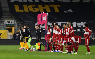 Liverpool players line-up before the Premier League match against Wolves at Molineux Stadium