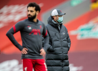Liverpool's manager Jürgen Klopp (R) and Mohamed Salah (L) during the pre-match warm-up before the FA Premier League match between Liverpool FC and Fulham FC at Anfield