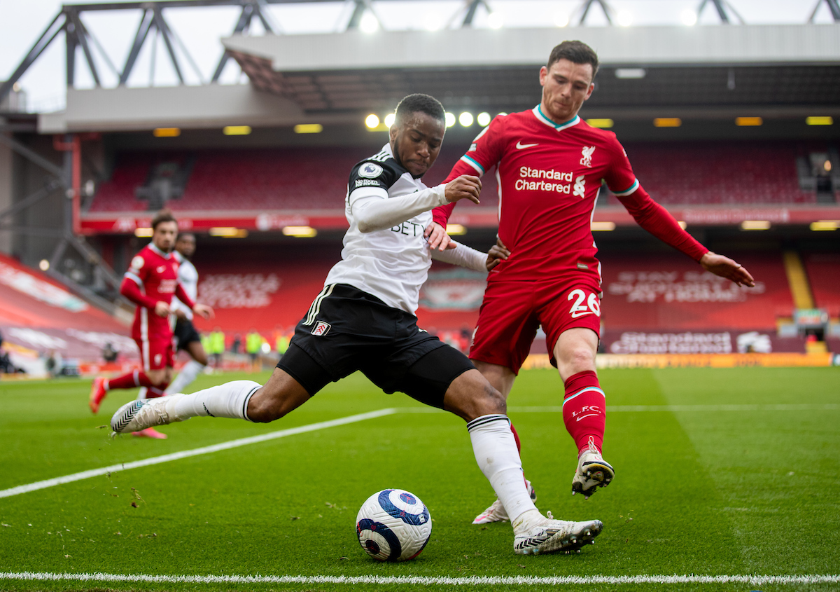 Fulham's Ademola Lookman (L) and Liverpool's Andy Robertson during the FA Premier League match between Liverpool FC and Fulham FC at Anfield