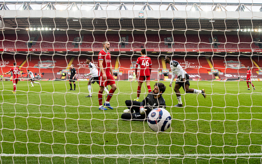 Liverpool's goalkeeper Alisson Becker looks dejected as Fulham score the opening goal during the FA Premier League match between Liverpool FC and Fulham FC at Anfield
