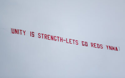 """A plane banner flies over Anfield with the message """"Unityt is strength - Lets (sic) go Reds YNWA"""" during the FA Premier League match between Liverpool FC and Fulham FC at Anfield"""
