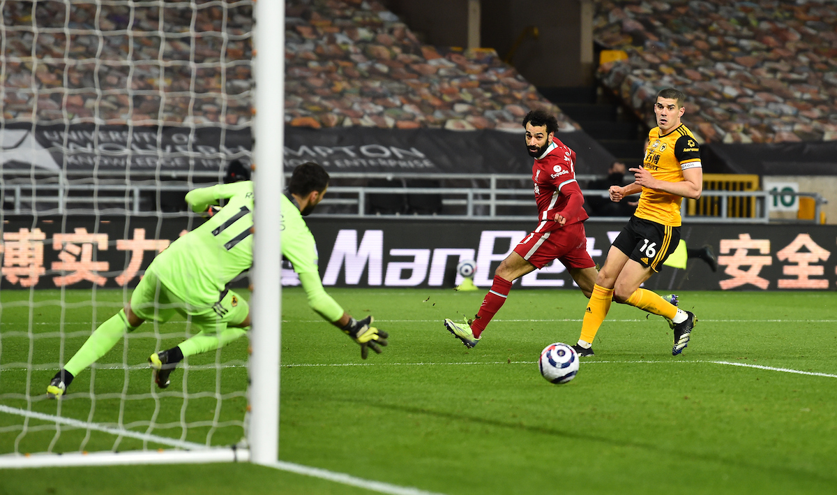 Mohamed Salah sees his shot saved by Rui Patricio during the Premier League match between Wolves and Liverpool FC at Molineux Stadium