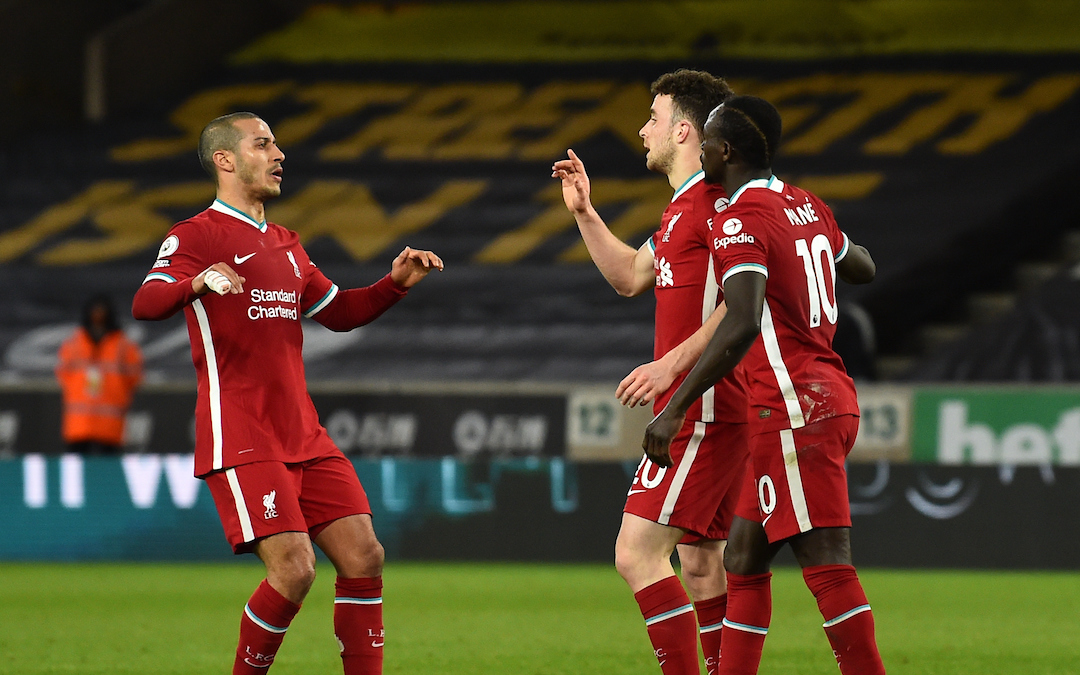 Liverpool's Diogo Jota celebrates with Thiago Alcantara and Sadio Mane after scoring the first goal during the Premier League match between Wolves and Liverpool FC at Molineux Stadium
