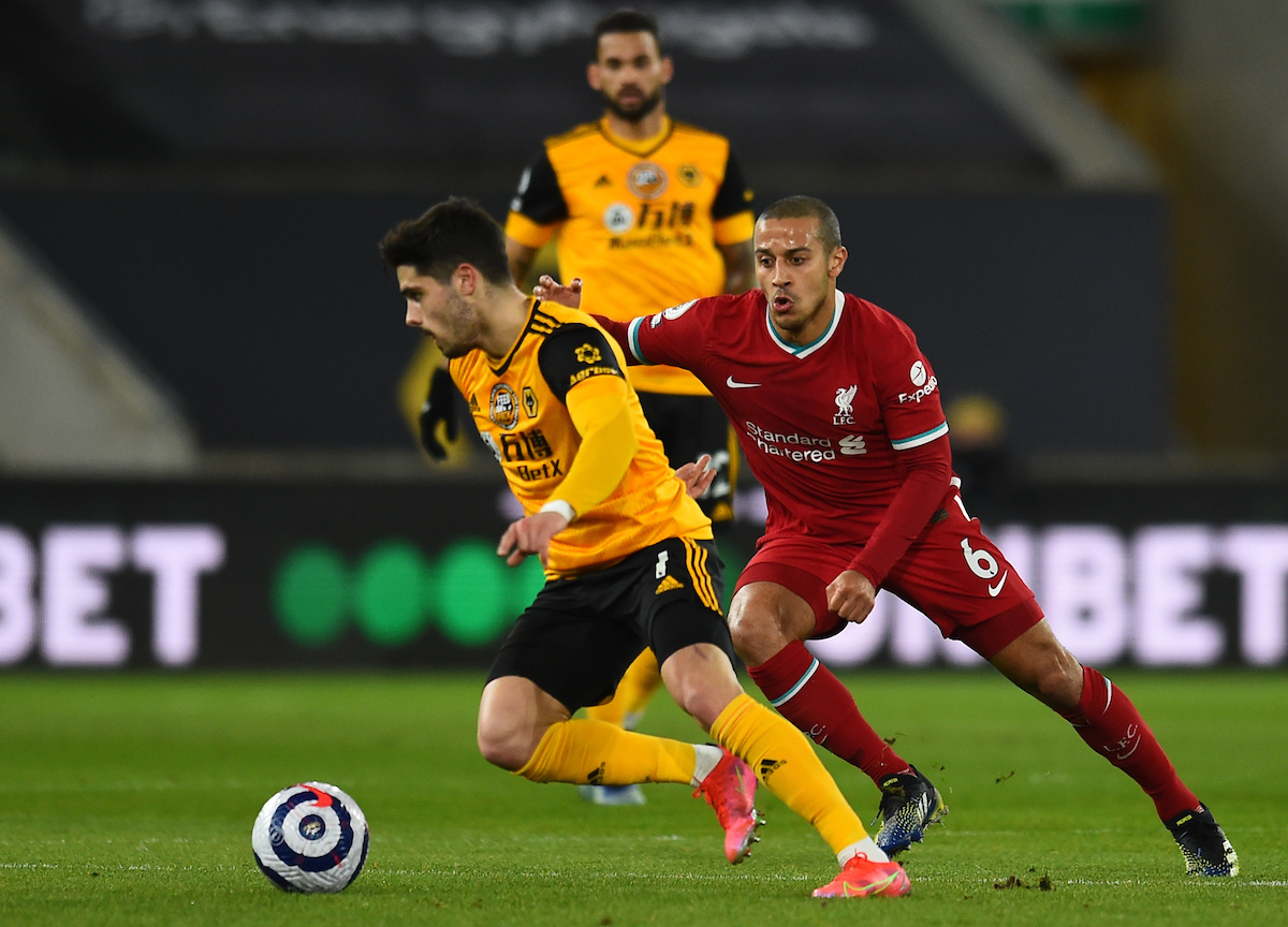 Pedro Neto and Thiago Alcantara during the Premier League match between Wolves and Liverpool FC at Molineux Stadium