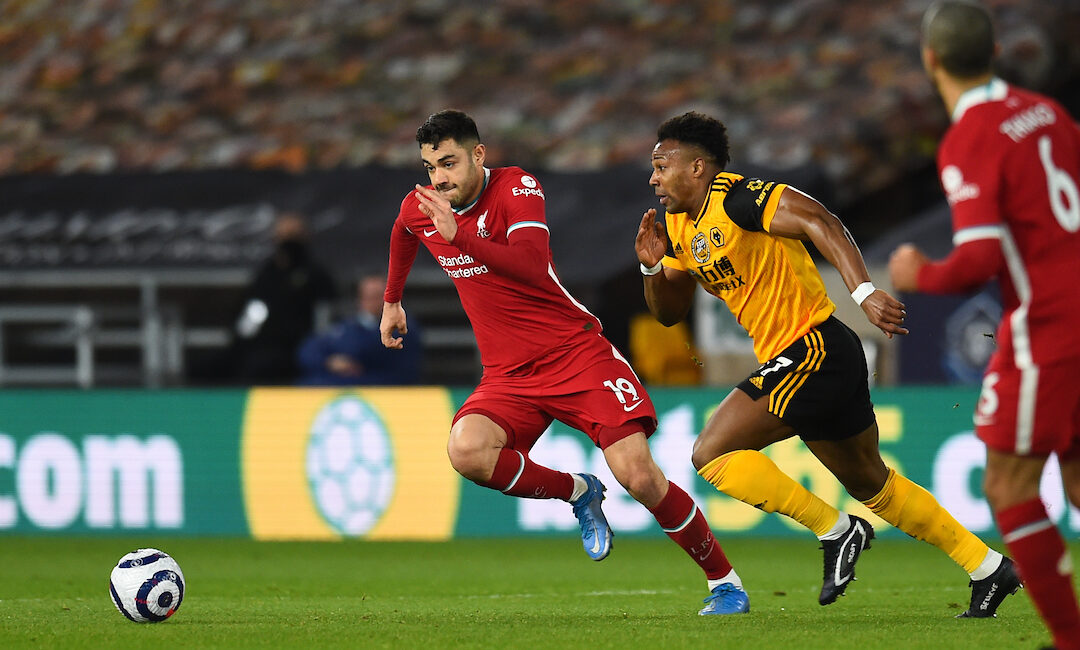 Ozan Kabak and Adama Traore during the Premier League match between Wolves and Liverpool FC at Molineux Stadium