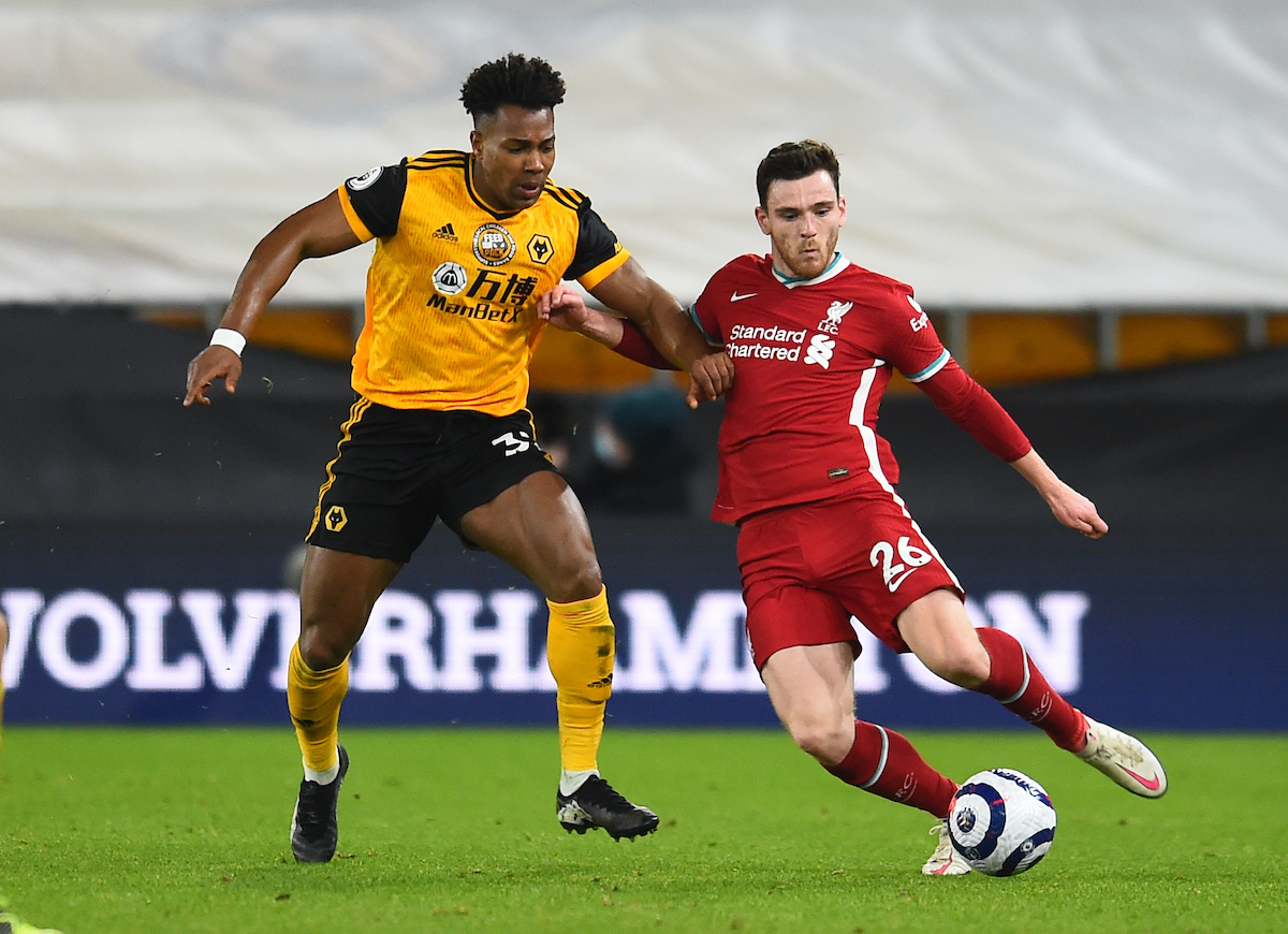Andy Robertson and Adama Traore during the Premier League match between Wolves and Liverpool FC at Molineux Stadium