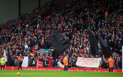 """Saturday, February 6, 2016: Liverpool supporters protest with black flags and banners """"Football without fans is nothing"""" before the Premier League match against Sunderland at Anfield."""