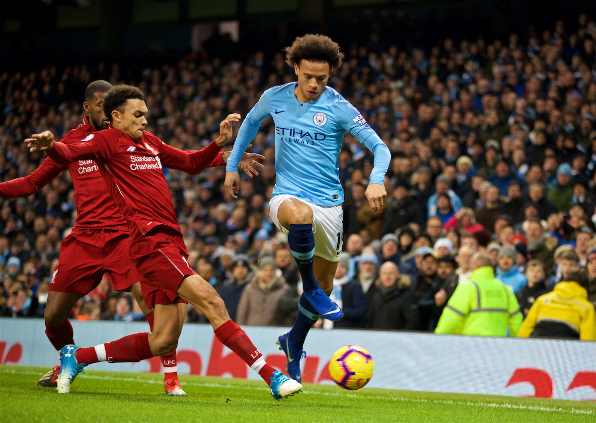 Thursday, January 3, 2019: Liverpool's Trent Alexander-Arnold (L) tackles Manchester City's Leroy Sane during the FA Premier League match between Manchester City FC and Liverpool FC at the Etihad Stadium.