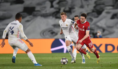 MADRID, SPAIN - Tuesday, April 6, 2021: Liverpool's Diogo Jota (R) gets away from Real Madrid's Toni Kroos during the UEFA Champions League Quarter-Final 1st Leg game between Real Madrid CF and Liverpool FC at the Estadio Alfredo Di Stefano.
