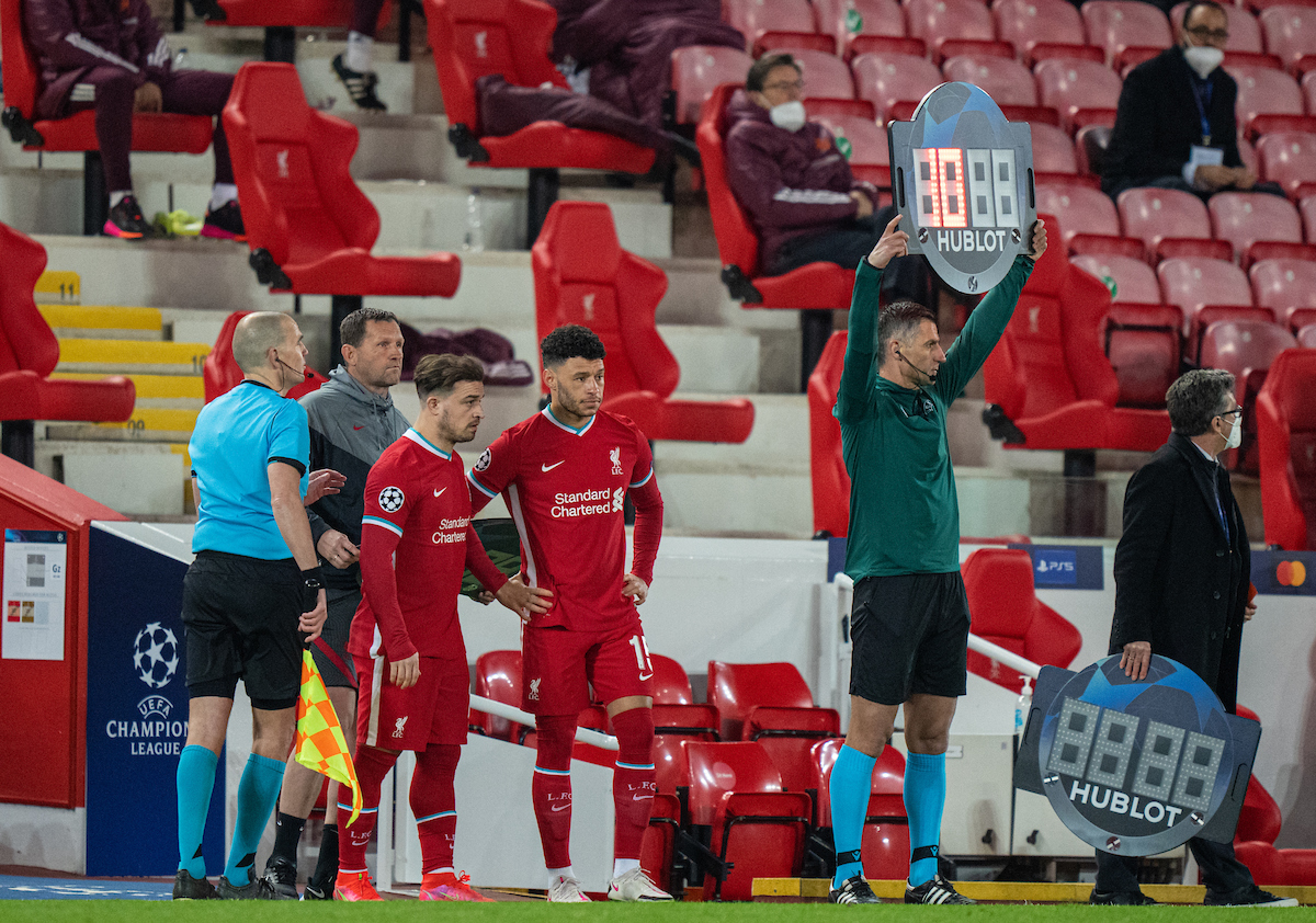 Wednesday, April 14, 2021: Liverpool's substitutes Xherdan Shaqiri (L) and Alex Oxlade-Chamberlain prepare to come on during the UEFA Champions League Quarter-Final 2nd Leg game between Liverpool FC and Real Madrid CF at Anfield. The game ended in a goal-less draw, Real Madrid won 3-1 on aggregate.