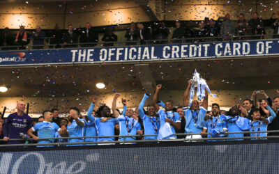 Manchester City lift the trophy after beating Liverpool on penalties during the Football League Cup Final match at Wembley Stadium.